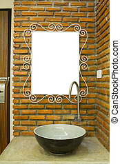 Lavatory and mirror near the door.