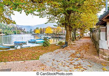Autumn landscape of Lavena Ponte Tresa, is village located on the western shore of Lugano lake, Italy
