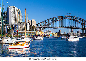 The view across Lavendar Bay from Quiberie Park towards Sydney Harbour Bridge in Sydney, Australia