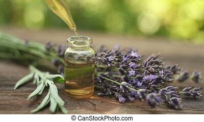 lavendel, essentiële olie, in, mooi, fles, op, tafel