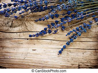 Lavender border over wooden background