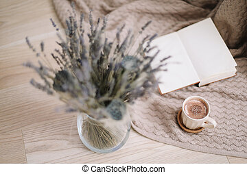 lavender bouquet with book and cup of coffee on wooden background. Dried flowers and a cup of cappuccino  with book, spring concept. top view. flatlay