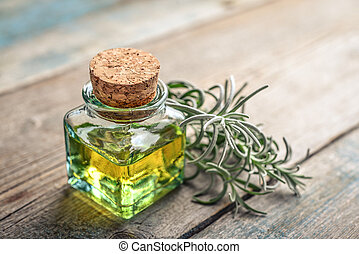 Lavender essential oil in a glass bottle with cork stopper ...