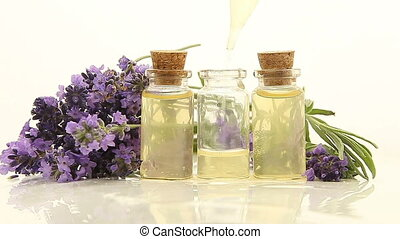 lavender essential oil in beautiful bottle on White...