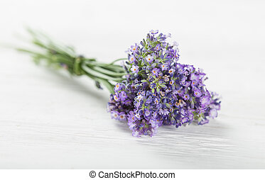 Lavender flowers on wooden table.