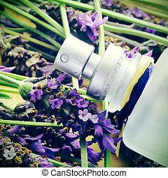 lavender fragrance - a bottle of lavender cologne on a pile...