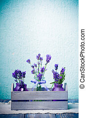 Lavender in bottles, decor provance style, wooden box on crochet tablecloth