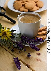 Lavender next to cup of creamy coffee