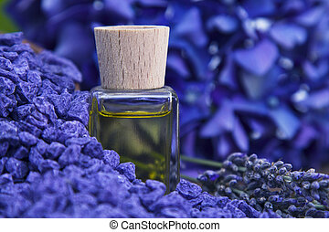lavender oil on wooden background