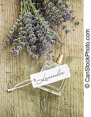 Lavender perfume bottle with label and flowers