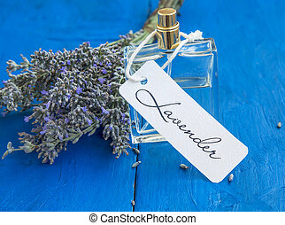 Lavender perfume bottle with label and lavender flowers bunch