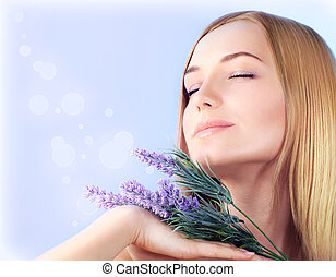 Lavender spa aromatherapy - Young woman enjoying lavender...