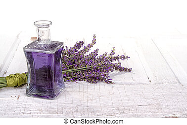 Lavender spa still life with bottle of lavendar infused oil ...
