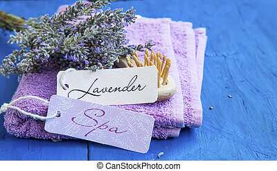 Lavender spa with labels on towels and lavender bunch