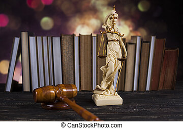 Law book, mallet of the judge, justice scale, wooden desk background