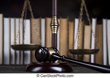 Law book, mallet of the judge, justice scale, wooden desk...