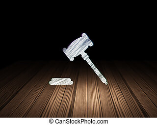 Law concept: Gavel in grunge dark room