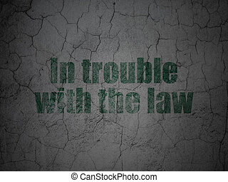 Law concept: In trouble With The law on grunge wall background