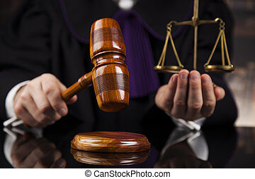 Law concept, Male judge in a courtroom striking the gavel -...