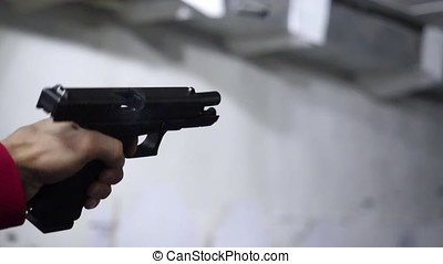 Law enforcement aim pistol by two hand in academy shooting...