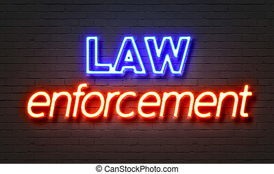 Law enforcement neon sign on brick wall background. - Law...