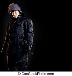 Law Enforcer Ready for Crowd Control - Law enforcer in...