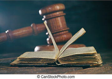 Law gavel on old brown leather book