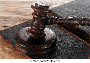 Law gavel or judge mallet on a wooden desk