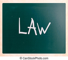 """Law"" handwritten with white chalk on a blackboard"