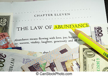 Law of abundance concept - with many denominations of currency