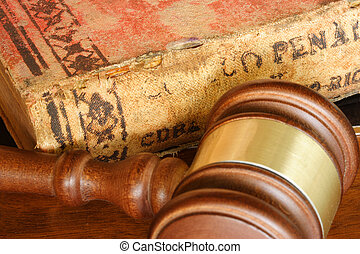 Law - Judge hammer and old legal code