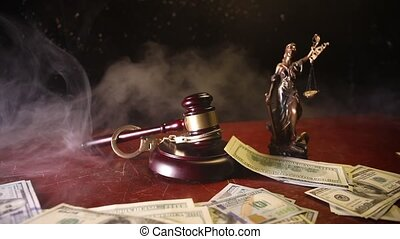 Law theme, mallet of the judge on wooden desk with Lady...