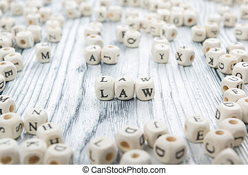 Law word written on wood block. Wooden ABC