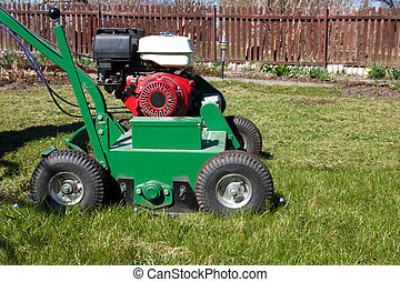 Lawn Aerator.A lawn aerator is a garden tool or machine...