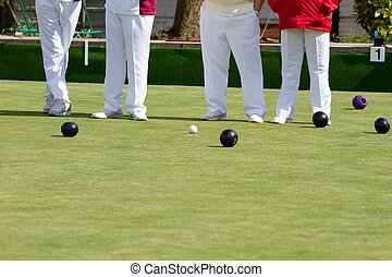 Lawn bowling - bowls being played on a lawn