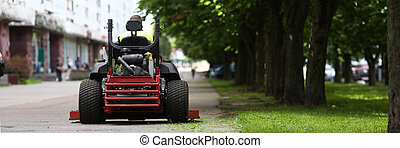 Lawn care and mowing - Close-up of professional lawn mower ...