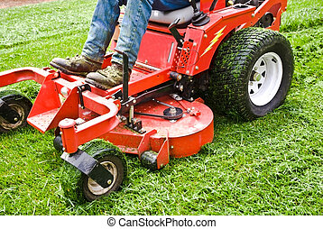 Lawn Care Riding Mower - Man on a riding lawn mower that has...