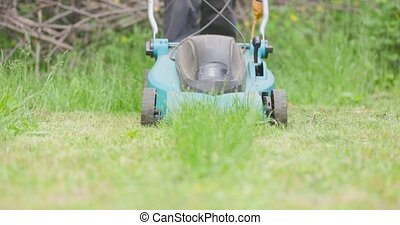 Lawn mover closeup footage in slow motion