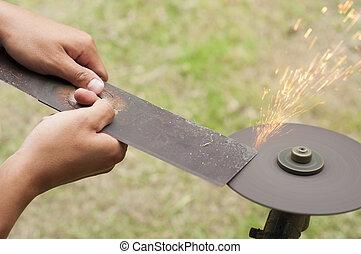 Lawn mower blade sharpening.