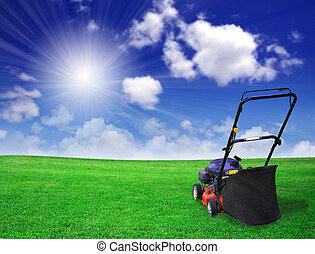 Lawn mower on green field