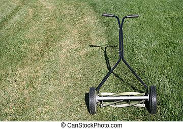 Lawn Mower - Reel type manual lawn mower. Metaphor for home...