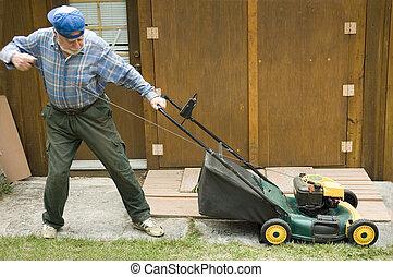 Lawn mower starting - Senior starting manually a lawn mower,...