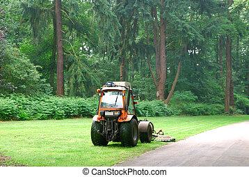 Lawn mower machine mowing the lawn in a formal garden....