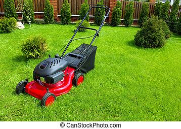 Lawn mower in the garden