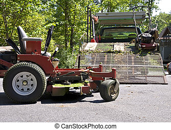 Lawn Service Equipment - A large truck with mowers ready to...