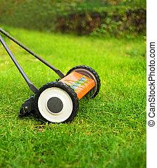 Lawnmower cutting grass