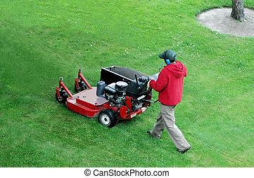 Lawnmower Man - A man mowing the lawn