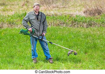 Lawnmower man green field cultivating