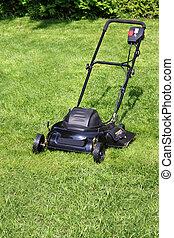 lawnmower - Black lawnmower on freshly cut yard grass