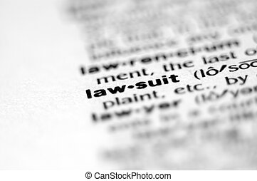 LAWSUIT - Extreme macro or close up of the word LAW-SUIT....